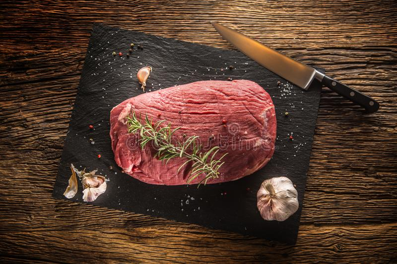 Beef steak. Raw Flank steak with rosemary garlic salt and pepper stock photo