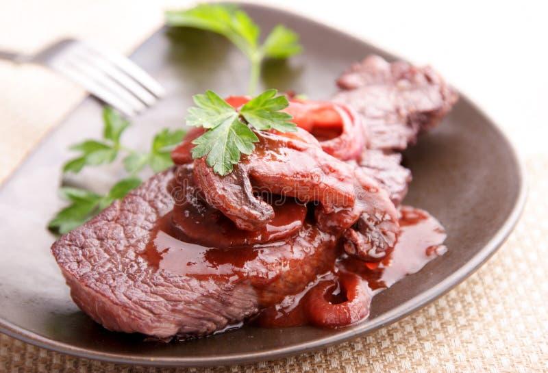 Beef steak in redwine royalty free stock image