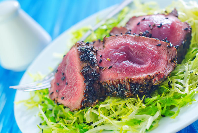 Beef steak. With salad on plate stock image