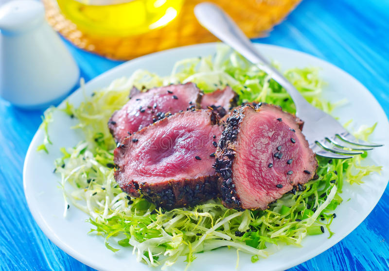 Beef steak. With salad on plate royalty free stock images
