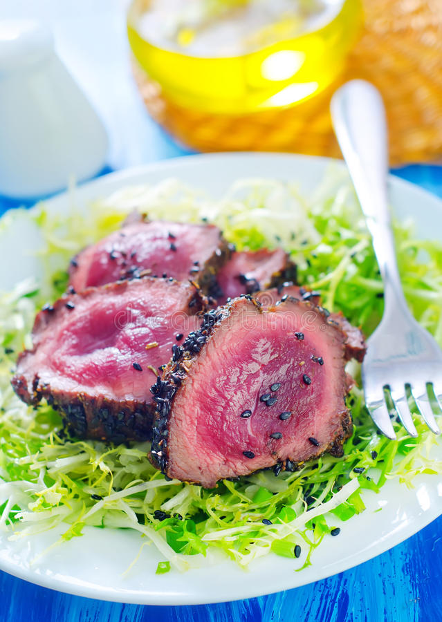 Beef steak. With salad on plate stock photo