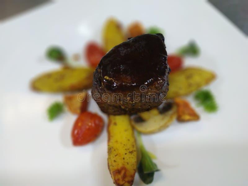 Beef steak with turn potatoes. Beef Tenderloin steak serve with turned potatoes , cherry tomatoes stock image