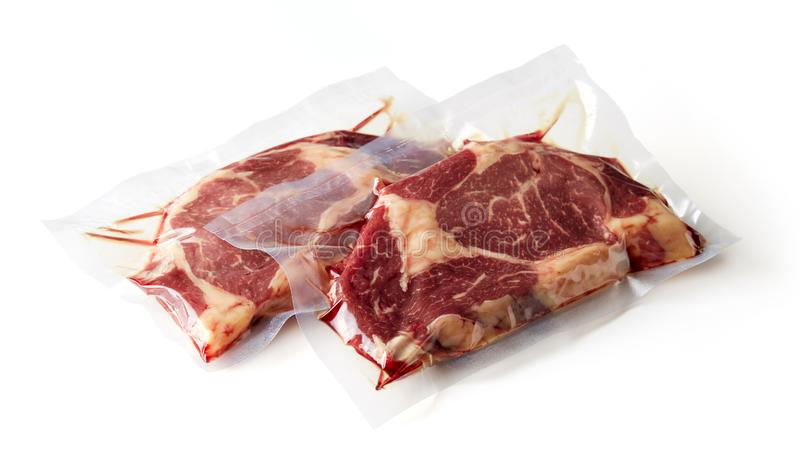 Beef steak vacuum sealed isolated on white. Beaf steak vacuum sealed ready for sous vide cooking isolated on white background stock images