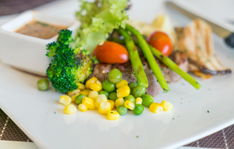 .Beef steak with vegetables royalty free stock photography