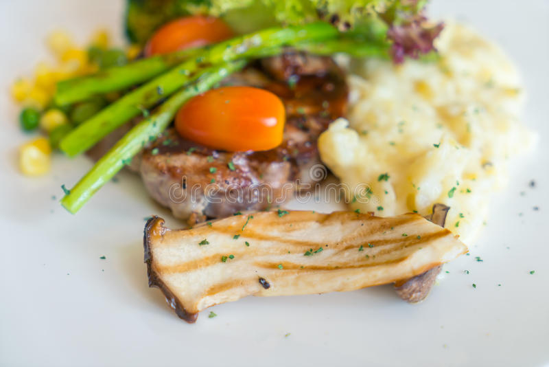 .Beef steak with vegetables stock image