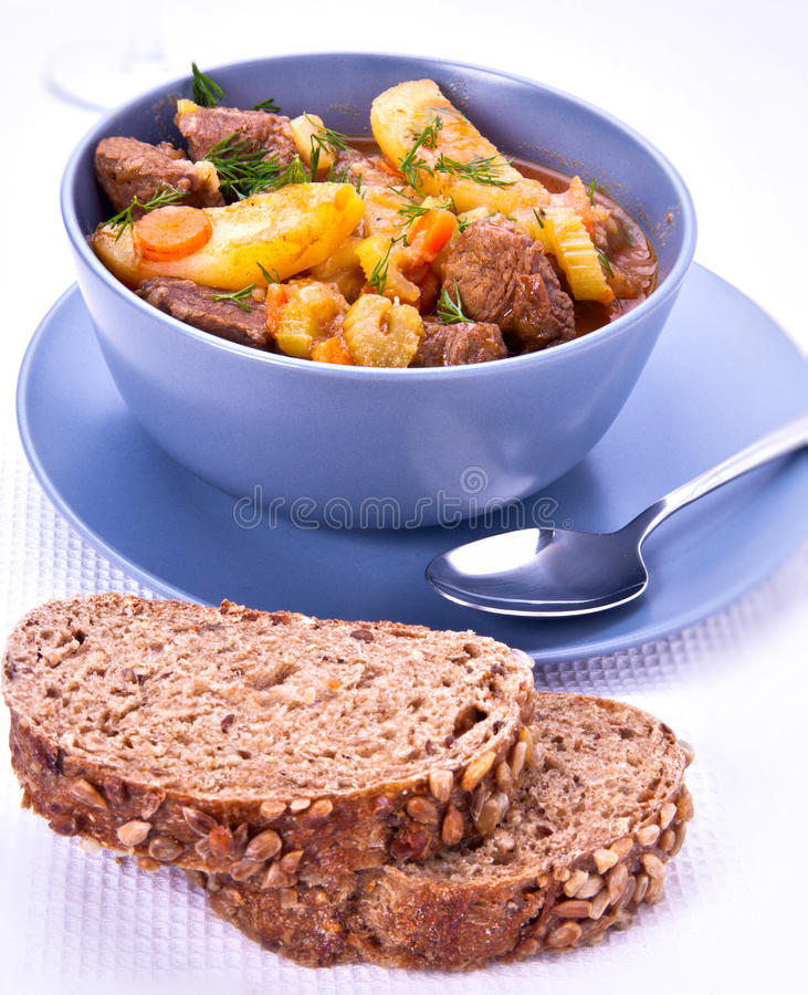 Beef stew. With sunflower bread in a bowl stock photos