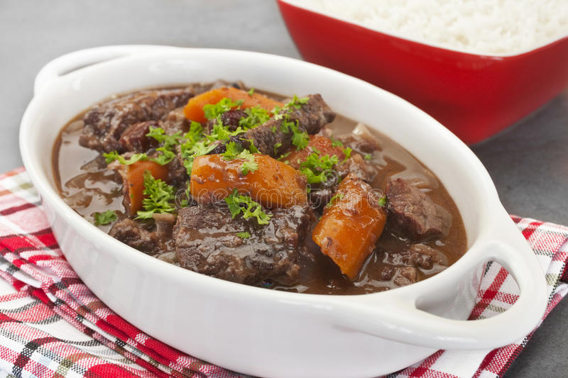 Beef Stew. A French stew, daube of beef Provencal has a delicious sauce made from red wine, stock, cinnamon, cloves, orange and herbs. Here it is served with royalty free stock image