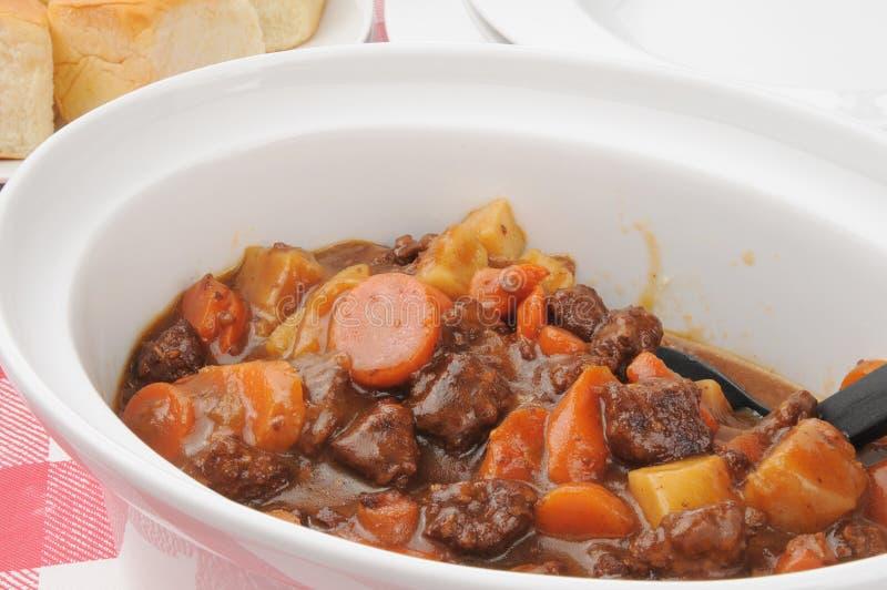 Beef stew in a crock. A serving crock of beef stew royalty free stock image