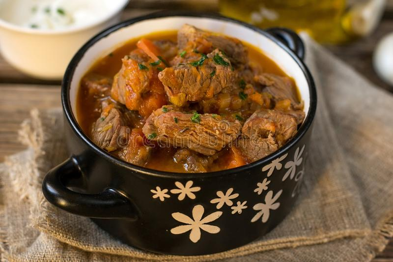 Beef stew goulash style in tomato sauce with carrots. And leeks stock photography