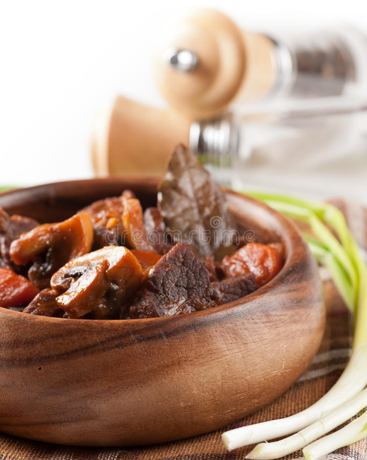 Beef stew with mushrooms. And carrots served in a bowl stock images