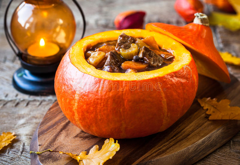 Beef stew in pumpkin. Beef stew with vegetables in pumpkin stock photo