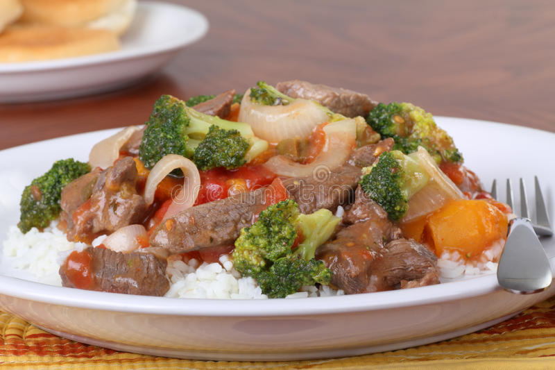 Beef Stir Fry. With vegetables on rice royalty free stock photo