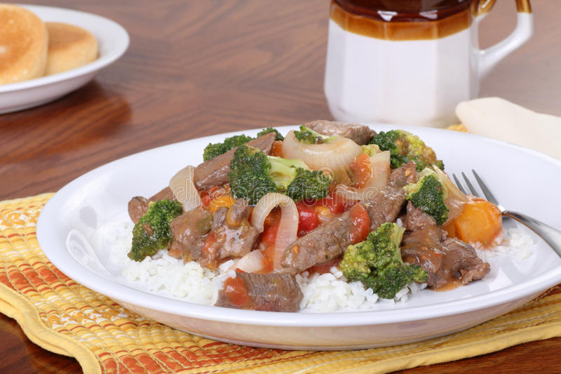 Beef Stir Fry. With vegetables on rice stock photos