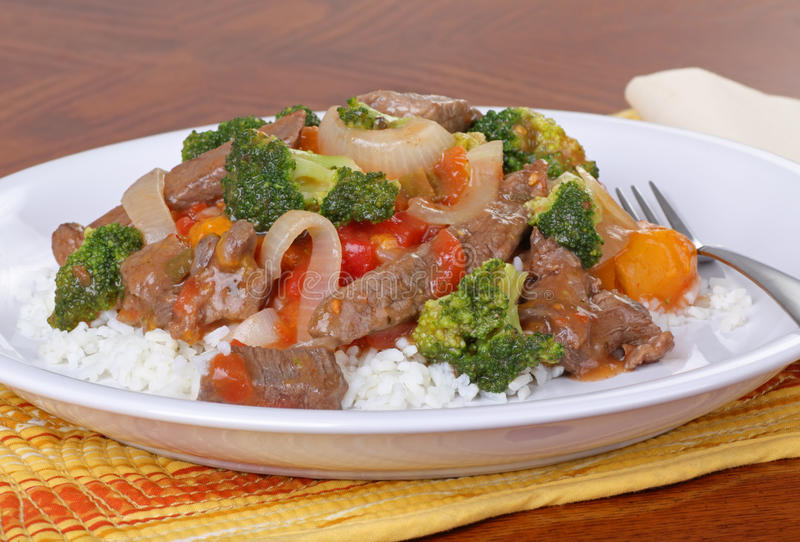 Beef Stir Fry. With vegetables on rice stock photo