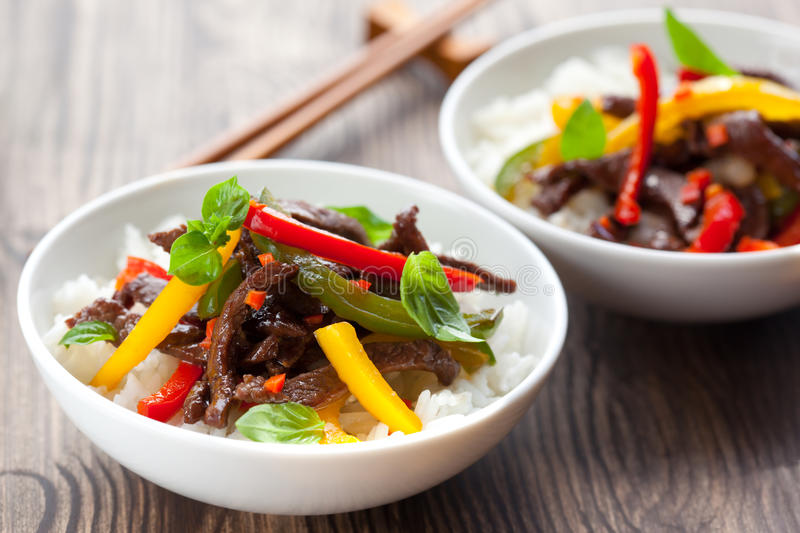Beef stir-fry. With vegetable and rice stock image