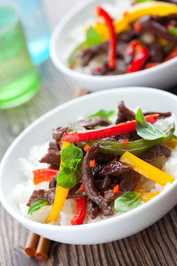 Beef stir-fry. With vegetables and rice stock image