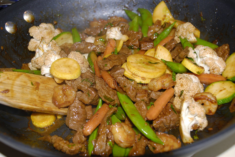 Beef Stir Fry. Stir Fry being cooked in a frying pan royalty free stock images
