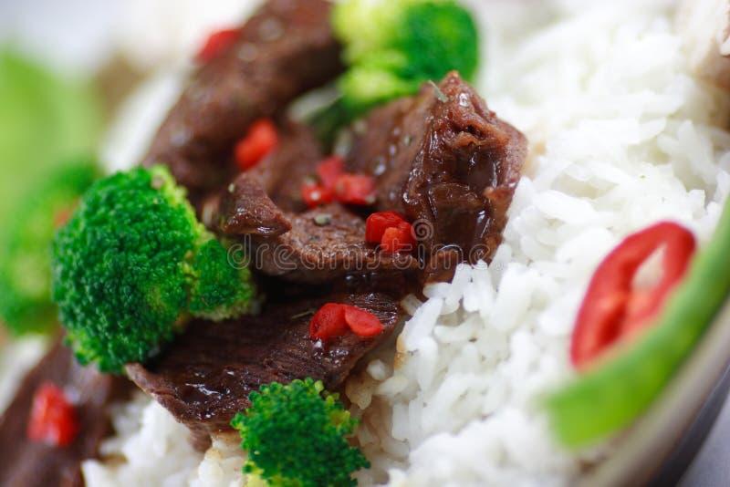 Beef stir fry macro. Beef stir fry on white with veggies close up stock photos
