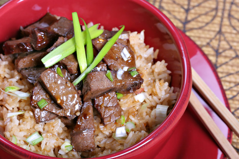 Beef stir-fry rice. Traditional Chinese food - twice cooked beef stir fry rice royalty free stock photos