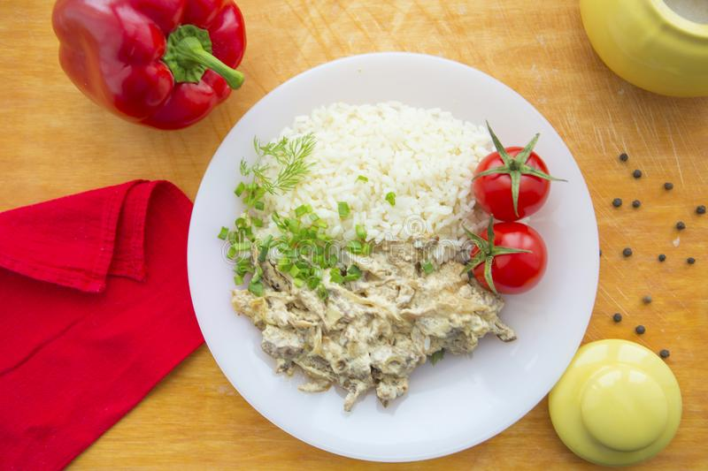 Beef stroganoff and rice close-up on a plate on the table. stock image