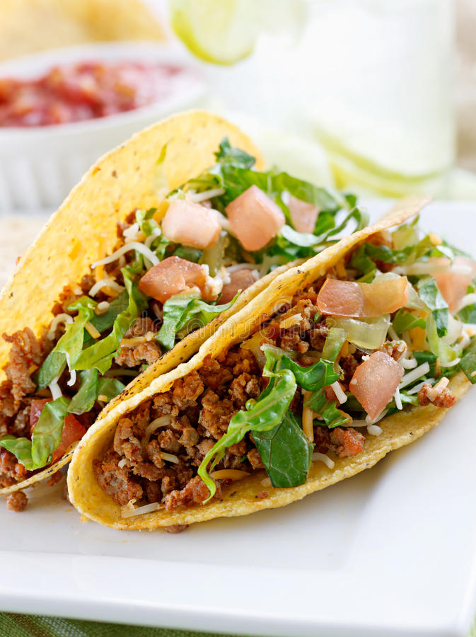 Beef tacos with lettuce cheese, tomato. and lettuc royalty free stock images