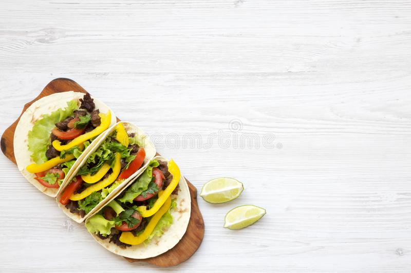 Beef tacos with salad and pepper. Top view. From above, overhead. stock photo
