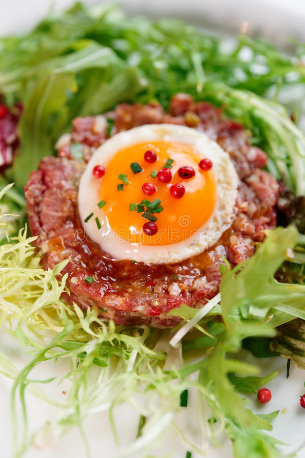 Beef tartare in plate, close-up. Shot stock image