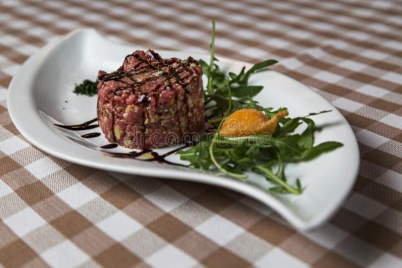 Beef tartare a summer appetizer to serve cold royalty free stock image
