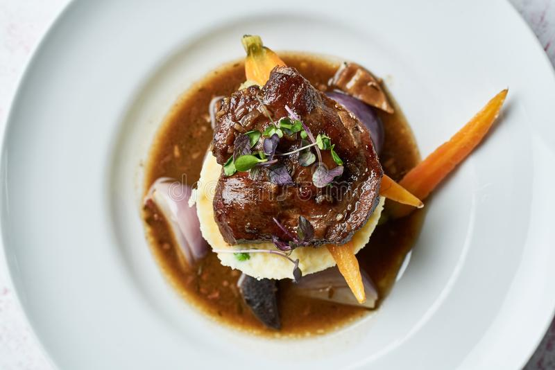 Beef tenderloin on white plate royalty free stock images