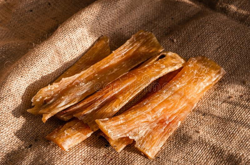 Chewing sticks for dogs. Air dried beef tendons. Natural treats for large and small dogs royalty free stock photography