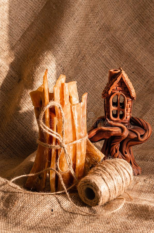 Still life with chewing sticks for dogs, beautiful guinea castle. On a rustic-style fabric background, Air Dried beef tendons. Nat stock photography