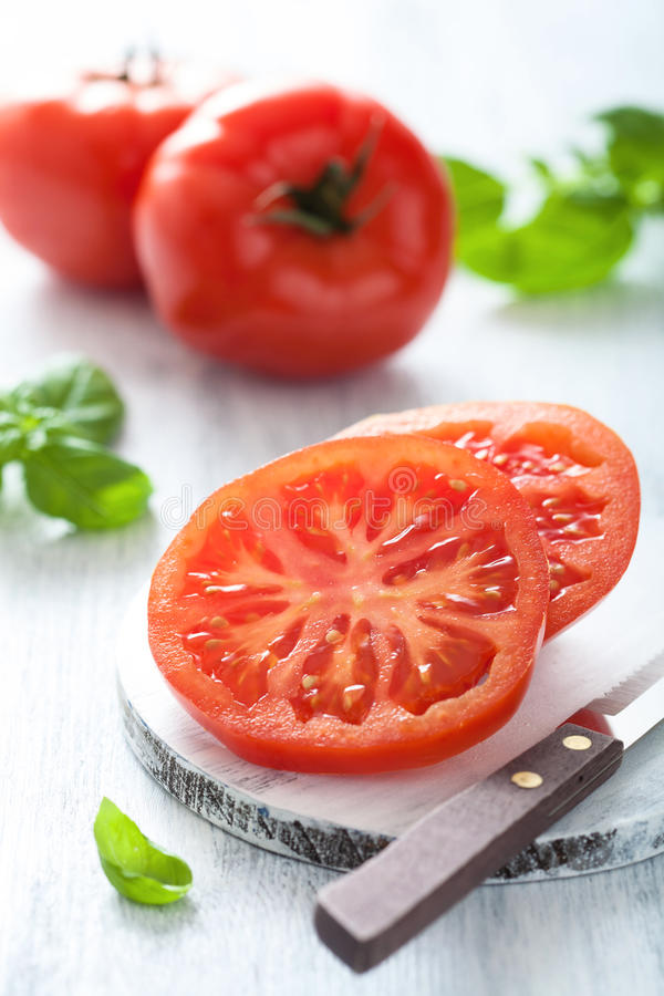 Download Beef Tomato Sliced On Cutting Board Stock Image - Image: 31726493