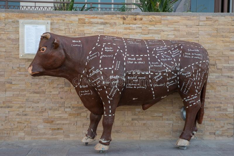 Beef types and names marked on Sculpted bull at BOA Steakhouse Abu Dhabi. November 10, 2018 _ Abu Dhabi, UAE: Beef types and names marked on Scaupted bull at BOA royalty free stock images