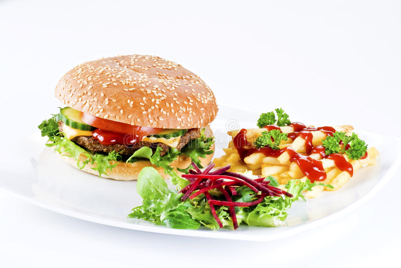 Beefburger meal. Beefburger with crispy salad leaves and chips stock photo