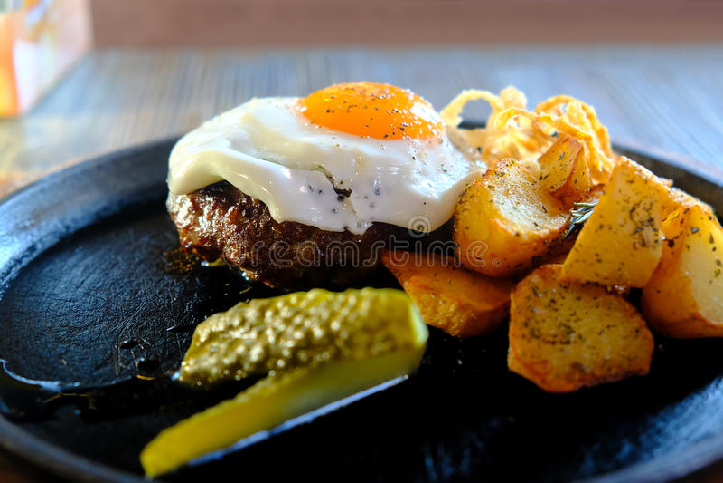 Beefsteak, fried egg, juicy meal stock photos