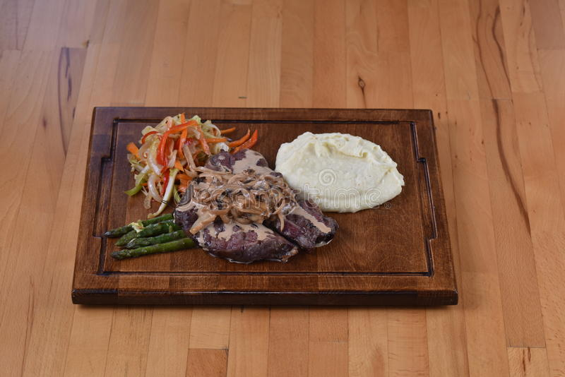 Beefsteak with Mashroom Sauce. Lamb Cutlet served with barbeque sauce stock images