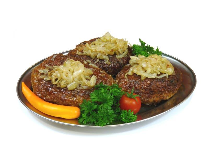 Beefsteaks mit Zwiebeln stockbilder