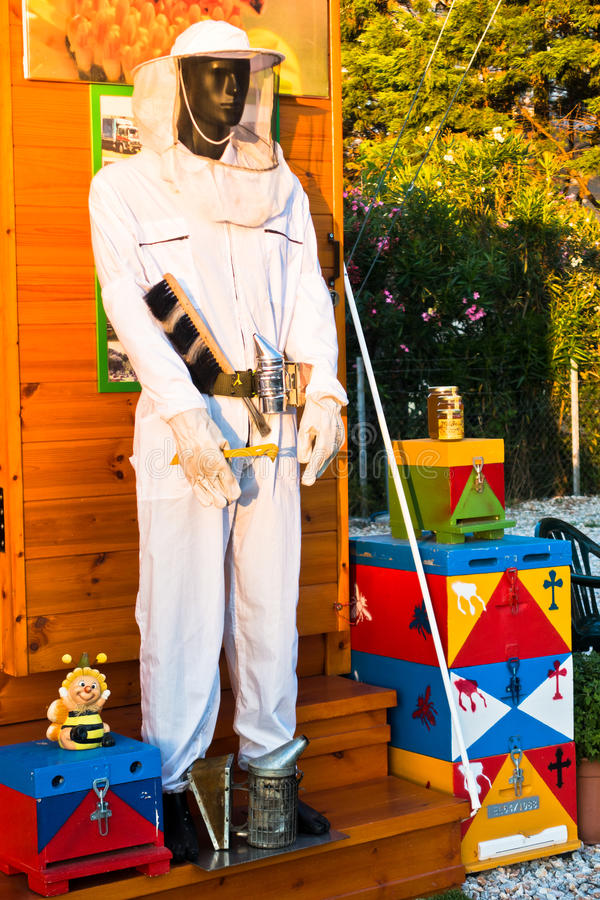 Beekeeper model with equipment and protective clothing stock images