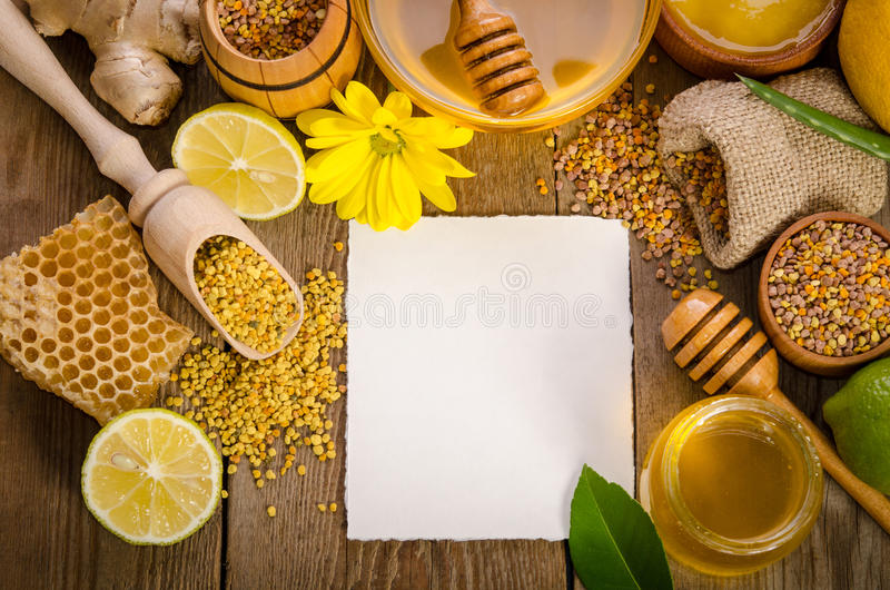Beekeeping products on a wooden table with empty card for text. Beekeeping products on a wooden table with empty card for you text . side view royalty free stock photography