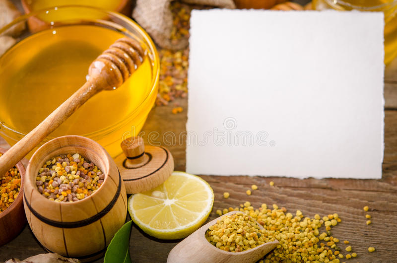 Beekeeping products on a wooden table with empty card for text. Beekeeping products on a wooden table with empty card for you text . side view royalty free stock photo