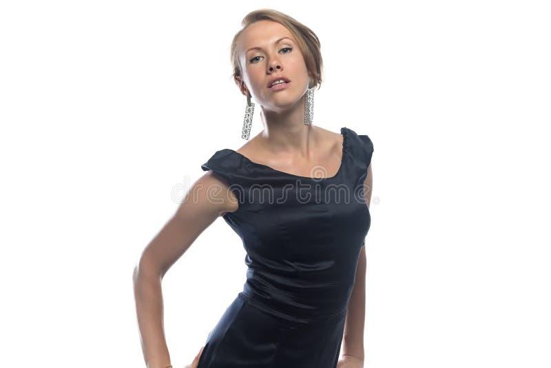 Beeld van blonde in zwarte kleding stock fotografie