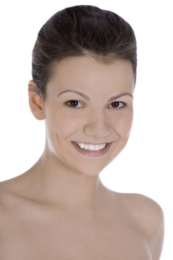 Beeld van het glimlachen brunette over wit stock foto's