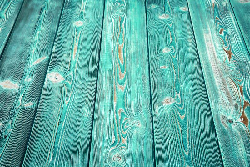 Beeld van hobbelig uitstekend houten die tafelblad met groene verf wordt geschilderd stock afbeeldingen