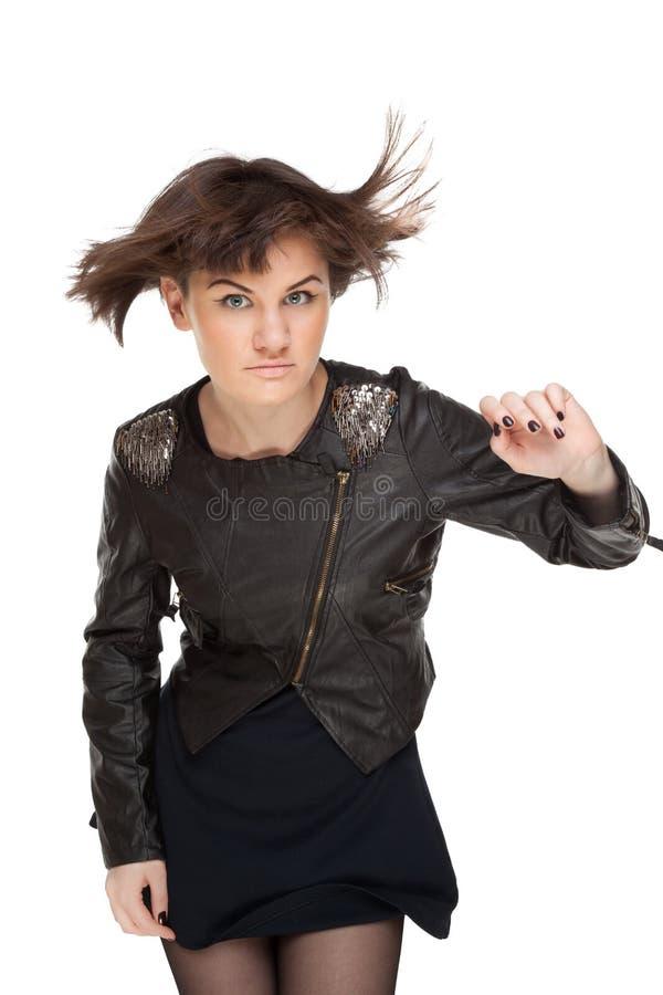 Beeld van modieuze vrouw met fladderend haar stock fotografie