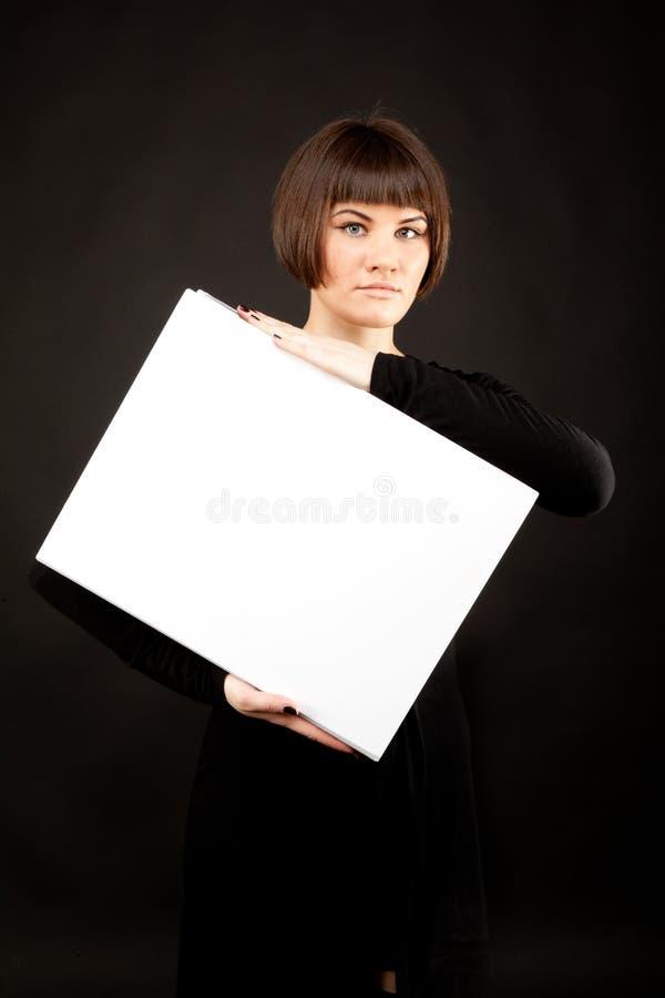 Beeld van mooie vrouw met wit boek royalty-vrije stock afbeelding
