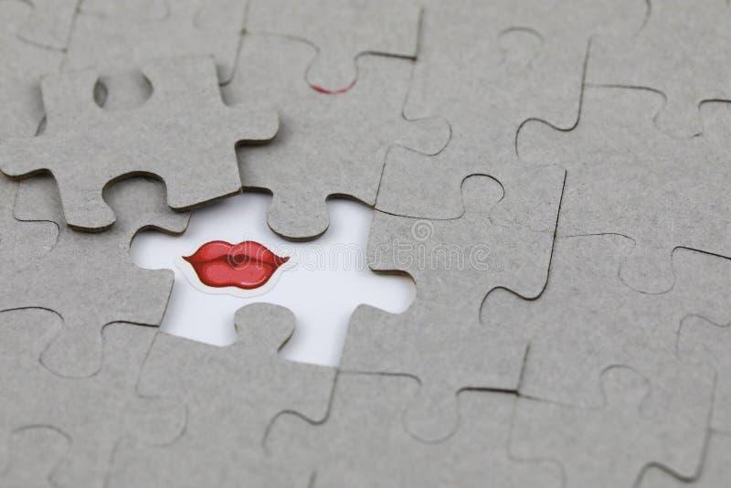 Beeld van Raadselstuk met Rode lippen De zaken, assembleren stock afbeelding