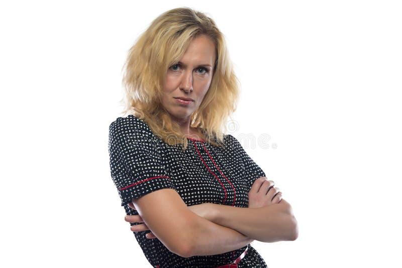 Beeld van vrouw met blond haar, gekruiste wapens stock foto's