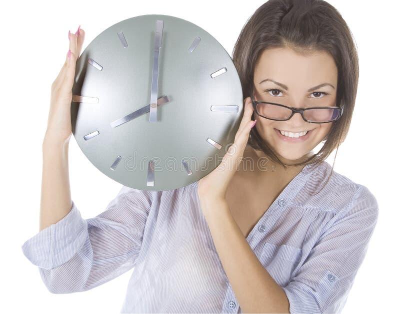 Beeld van vrouw met grote klok stock fotografie