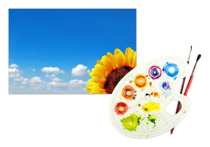 Beeld van zonnebloem en hemel op een document met palet royalty-vrije stock foto