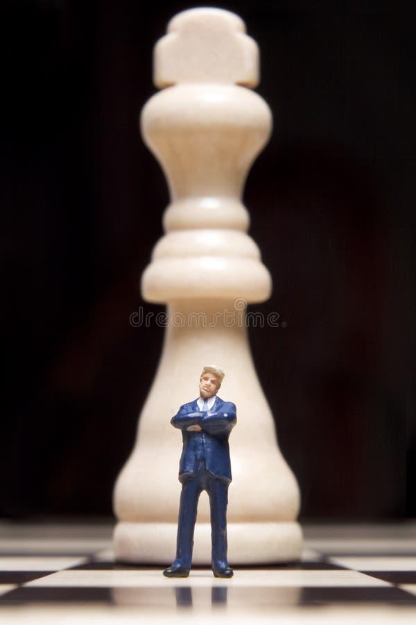 Beeldje en schaak stock afbeeldingen